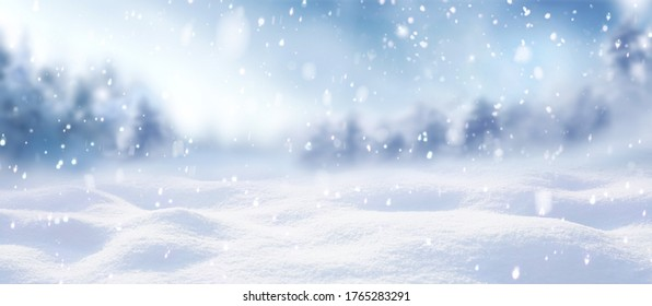 Beautiful winter background of snow and blurred forest in background, Gently falling snow flakes against blue sky, free space for your decoration. for your decorations. Wide panorama format. - Shutterstock ID 1765283291