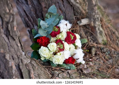 Beautiful winter bouquet of spruce, roses and cotton. The bride's bouquet. Wedding.