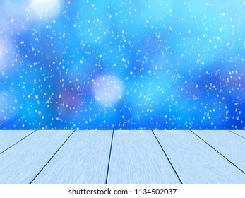 Beautiful winter design. Blue wood planks, in the background blurred bokeh and snowfall.