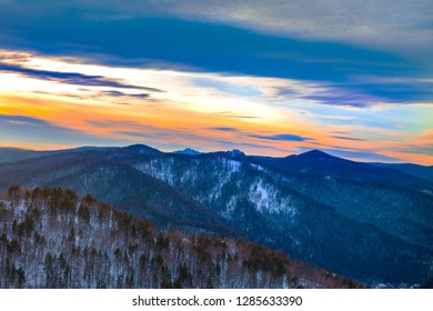 "Beautiful winter forest landscape at sunset. Krasnoyarsk, Russia, reserve ""Stolby"""