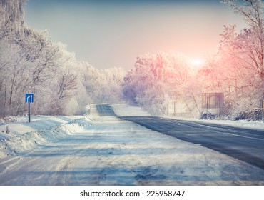 Beautiful winter landscape with a highway. Retro style.