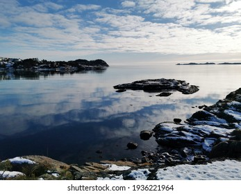 A beautiful winter landscape with a lake in Oteroya island, Larvik, Norway