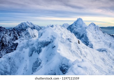 Beautiful winter landscape with lonely climber and snowed mountain peaks, High Tatras, Slovakia