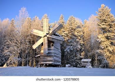 Beautiful winter landscape with a mill. Malye Korely