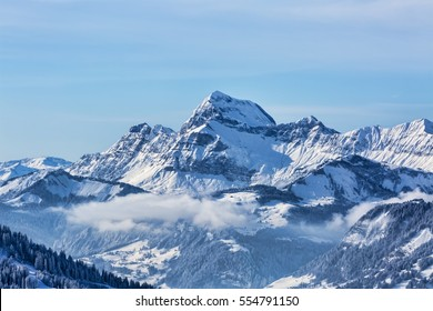 Beautiful winter landscape in the Mont Blanc Massif with the view to the Chaine des Aravis above the clouds.