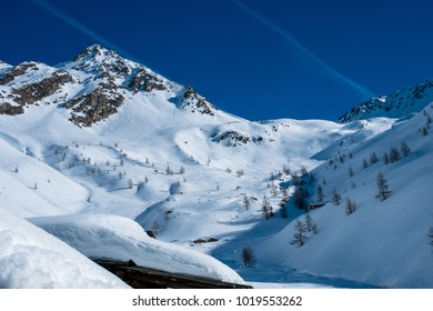Beautiful winter landscape in the mountains of East Tirol. Snow covered peaks under blue sky.