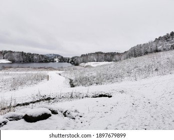 A beautiful winter landscape with the rural road covered with snow in Larvik, Norway
