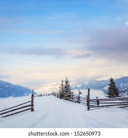 Beautiful winter landscape with snow covered trees. Dramatic sky. Carpathian, Ukraine, Europe.