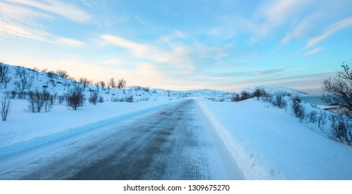 Beautiful winter landscape with snow and ice covered road - Tromso, Norway - Arctic landscape