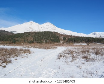 Beautiful winter landscape with snowy path and the peaks of mount Velino in the distance. It's a place near the town Massa d'Albe in province of L'Aquila, central Italy, part of the Abruzzo Apennines.