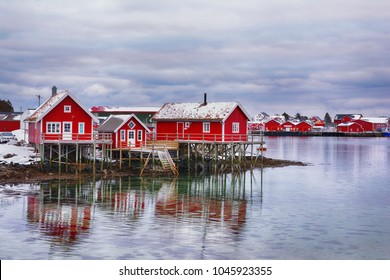 Beautiful winter landscape with traditional Norwegian fishing huts in Lofoten islands in Norwegian Sea, Norway