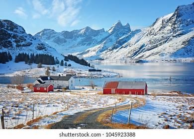 Beautiful winter landscape with traditional Norwegian fishing hut in the mountains of Lofoten islands in Norwegian Sea, Norway