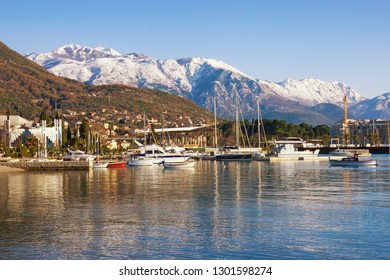 Beautiful winter Mediterranean landscape. Montenegro, Bay of Kotor. View of snowy Lovcen mountain and Tivat city