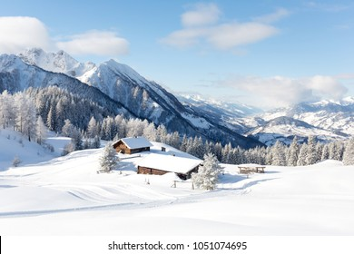 Beautiful winter mountain landscape with traditional mountain hut in Austrian Alps