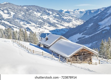 Beautiful winter mountain landscape with wooden hut, Saalbach, Austria