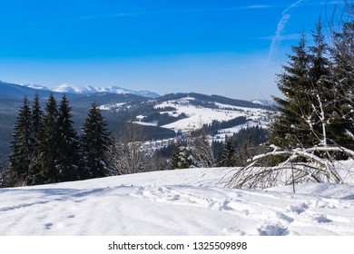 Beautiful winter mountain scenery with blue sky at sunny day