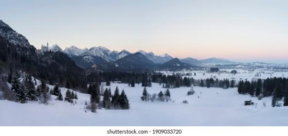 Beautiful winter panorama of Neuschwanstein and Hohenschwangau castle at sunrise