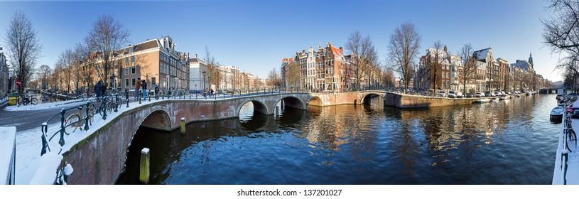 Beautiful winter panorama of the Unesco world heritage city canals of Amsterdam, The Netherlands.