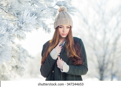 9d68826edf4 Beautiful winter portrait of young woman in the winter snowy scenery.