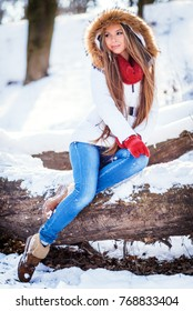 Beautiful winter portrait of young woman in the winter snowy scenery