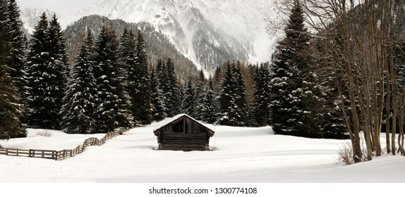 Beautiful winter scene near Antholz lake, val Pusteria. Alpin hut covered by snow, Italy.