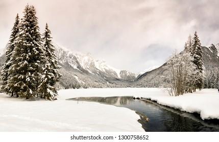 Beautiful Winter scene on frozen Antholz Lake, Val Pusteria, Italy.