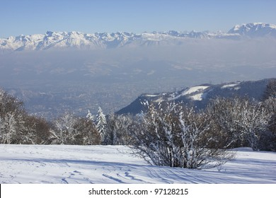 Beautiful winter scenery with view on Grenoble city from Plateau de Sornin, Vercors massif, near Grenoble, France