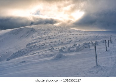 Beautiful winter sunny day on snowy mountains. Snow covered landscape in mountains. Snow trail on mountains.