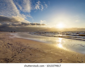 Beautiful winter sunset on the sandy beach of the Baltic Sea in Lithuania, Klaipeda