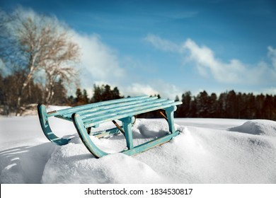 Beautiful winter time landscape with deep snow and a wooden sledge, winter holiday and vacation concept