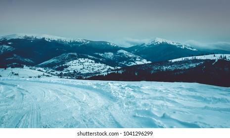 Beautiful winter view in Carpathian mountains, Ukraine, mountain panoramic landscape