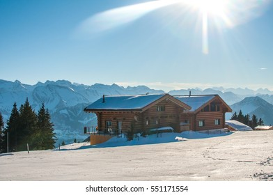 Beautiful winter view of chalet in Switzerland Alps, skiing season