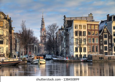Beautiful winter view on the Groenburgwal and the Southern church in Amsterdam, the Netherlands. HDR