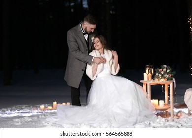 Beautiful winter wedding outdoors in evening