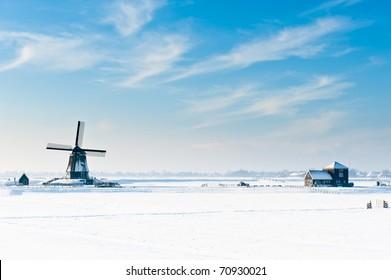 Beautiful winter windmill landscape in Oosthuizenthe Netherlands