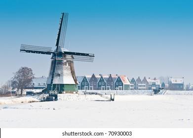 Beautiful winter windmill landscape in Volendam the Netherlands