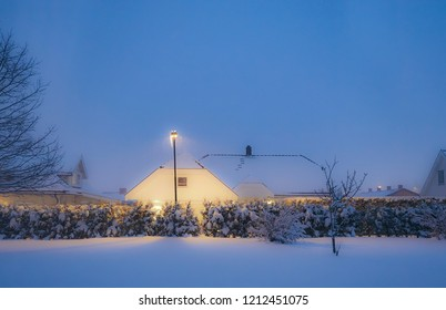 Beautiful wintery conditions, with fresh snow falling under lamp post in street in a winter wonderland of Norway