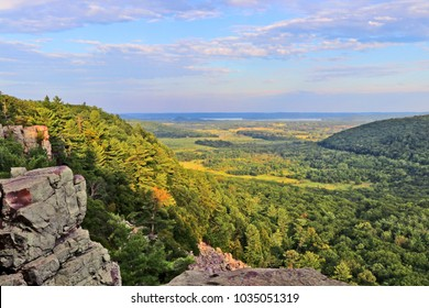 Beautiful Wisconsin summer nature background. Areal view from rocky ice age hiking trail during sunset hours. Devil's Lake State Park, Baraboo area, Wisconsin, Midwest USA.