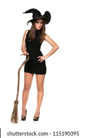 The  beautiful witch with a broom in a black dress