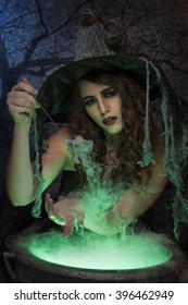 Beautiful witch with magic potion