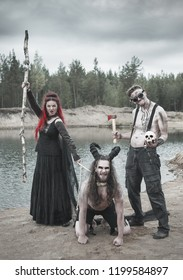 Beautiful witch with red hair, cannibal man and horned demon outdoor