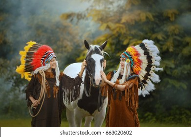 Beautiful womam sensuality elegance woman cowgirl on during sunset, brown leather jacket and hat.  Portrait women native american in nature. People and animals. Equestrian. vintage style