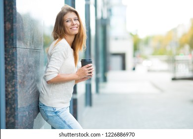 Beautiful woman 30 years old walking in the city on a sunny day