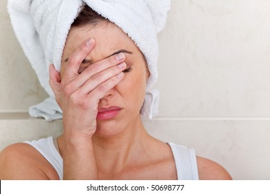 Beautiful woman after a bath having a headache