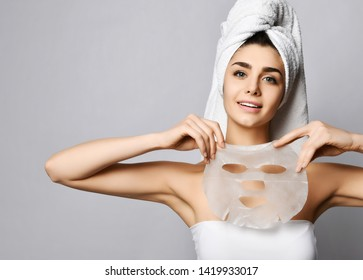 Beautiful woman after shower with just applied facial mask cream wonderful cosmetics effect and is inspired. Text space on white background