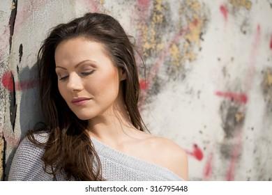 Beautiful Woman Against Graffiti Wall