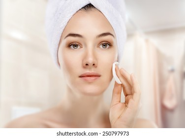 beautiful woman applying cosmetic cream
