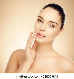 Beautiful woman. Applying facial cream or lip balm.