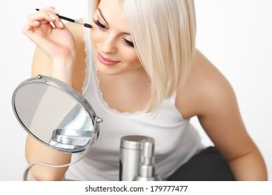 Beautiful Woman applying Mascara on Eyelashes. Eye Makeup