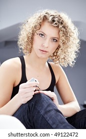 Beautiful Woman applying nail polish